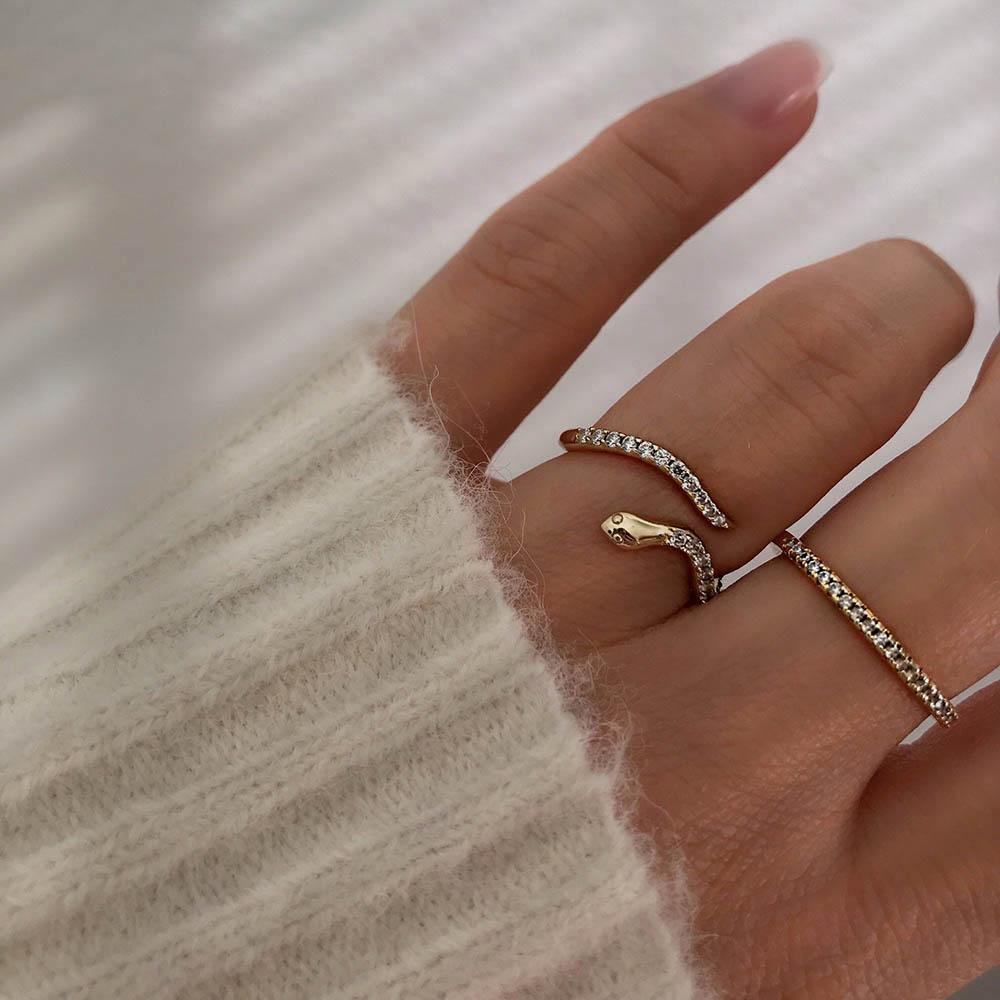 Boa Ring is an enchanting snake ring with clear cubic zirconia.The ring is raw and feminine at the same time and therefore one of our bestsellers. It is adjustable so you can easily adjust it yourself so it fits perfectly.