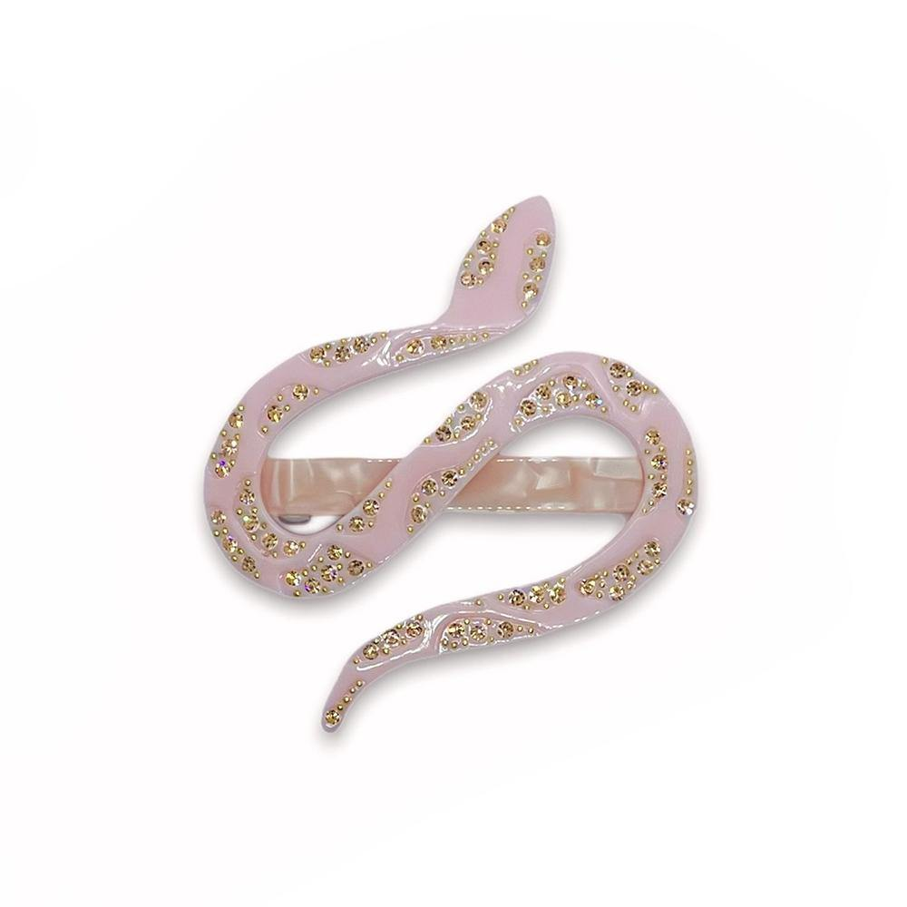 Beautiful and elegant hair clip in the shape of a snake covered with rhinestones. This stunning hair clip adds the perfect detail to your outfit with it's beautiful colors and many stones.