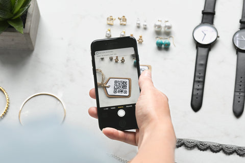 image of using a qr code to purchase an item with using block-chain technology on an android device in a retail store