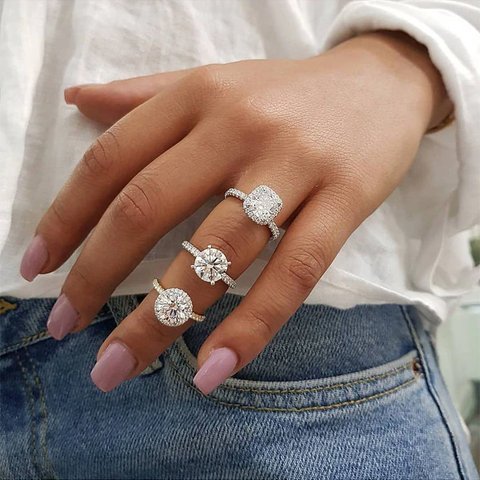 Halo engagement ring vs Solitaire