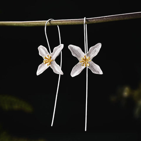 WHAT DO EARRINGS SYMBOLIZE? - Lily Flower Earrings