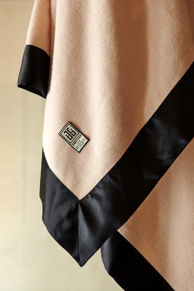 Close up of the super luxurious black silk borders on the camille luxury throw and blanket