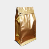 Quad seal gusset bag with zip lock in matte gold finish