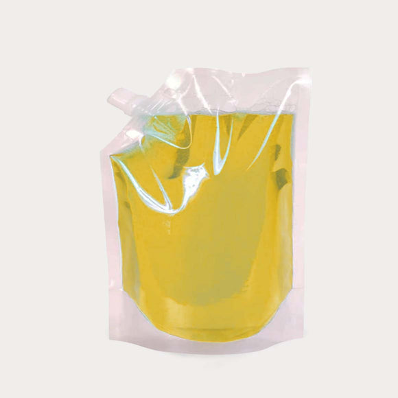 Liquid pouch spout transparent with juice