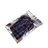 Silver flat pouch with zip lock used to pack shorts