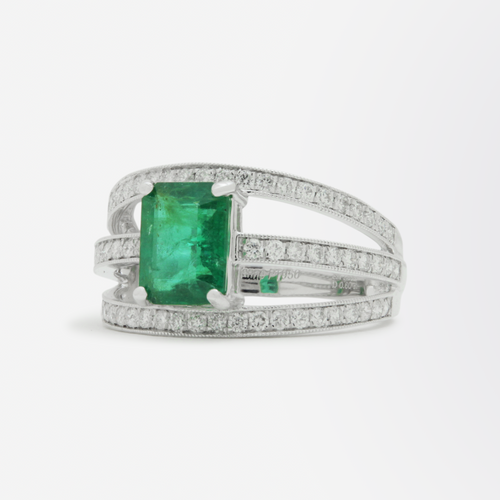 Three Row Platinum and Diamond Ring with Central Emerald
