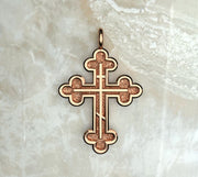 Rose gold or rose gold plated three budded cross with three bar inlay.
