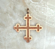Rose gold or rose gold plated three budded Greek cross.