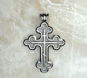 Saints of Christ Jewelry's Signature Three Budded Three Bar Orthodox Cross necklace and pendant in white gold or silver.