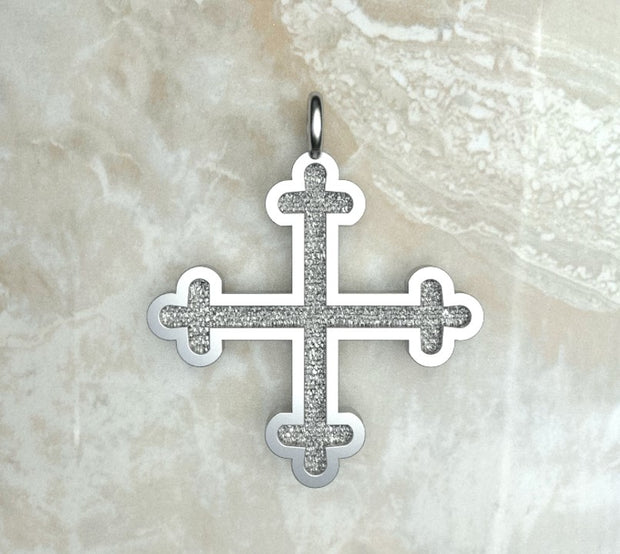 Sterling silver or white gold three budded Greek cross.