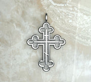 Sterling silver or white gold three budded cross with three bar inlay.