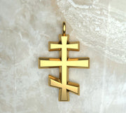 Yellow gold or yellow gold plated round beveled three bar orthodox cross.