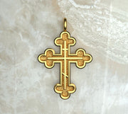 Yellow gold or yellow gold plated three budded cross with three bar inlay.