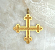 Yellow gold or yellow gold plated three budded Greek cross.
