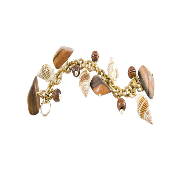 tropical brass charm bracelet with wood & shells