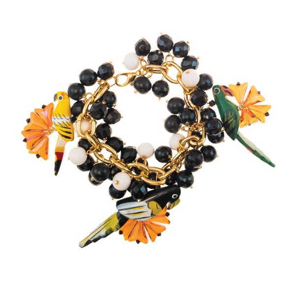 tropical style parrot charm bracelet with orange swarovski crystal charms and black and white bone charms