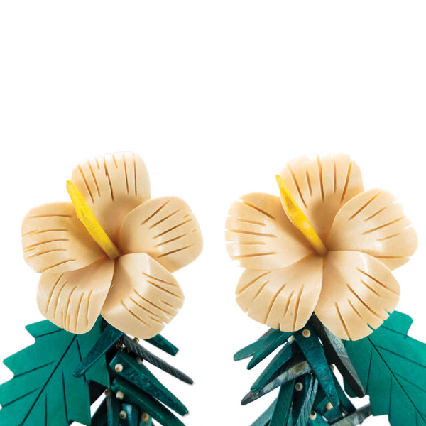 close up tropical vintage wood hibiscus flowers remade into earrings with coco stick charms