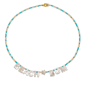 "tropical beach necklace mother of pearl letters that reads ""beach bum"" on seed bead strand"