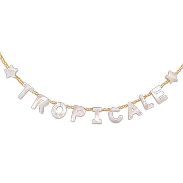 "beach style necklace that reads ""tropicale"" in mother of pearl letters with seed bead strand"
