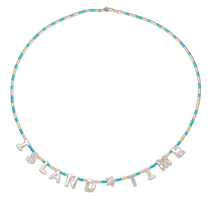 "Beach necklace that reads ""Island Time"" in mother of pearl letters and seed beads"