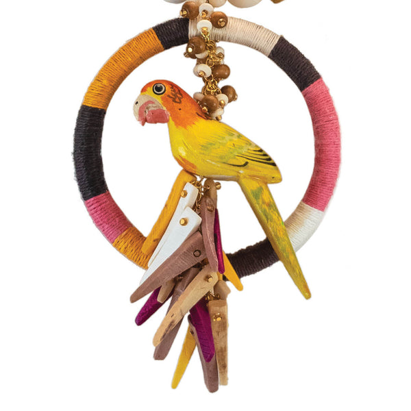 close up of tropical yellow parrot with multi color hemp wrapped ring with coco stick charms and wood beads