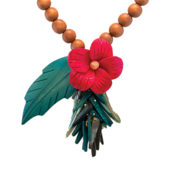 tropical necklace with red hibiscus flower carved in wood and green leaf on natural wood bead strand with green coco stick and mother of pearl charms