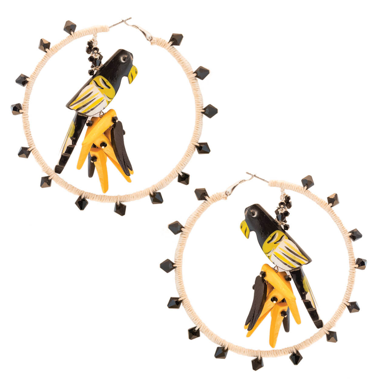 Tropical style ivory hemp wrapped hoop earrings with black and yellow parrots hanging from center with yellow and black coco stick charms and black Swarovski crystals.