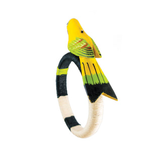 back view of tropical style yellow parrot bracelet wrapped in black, ivory, lime hemp