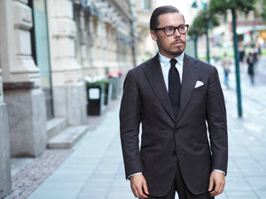 The black grenadine tie (with a brown suit)