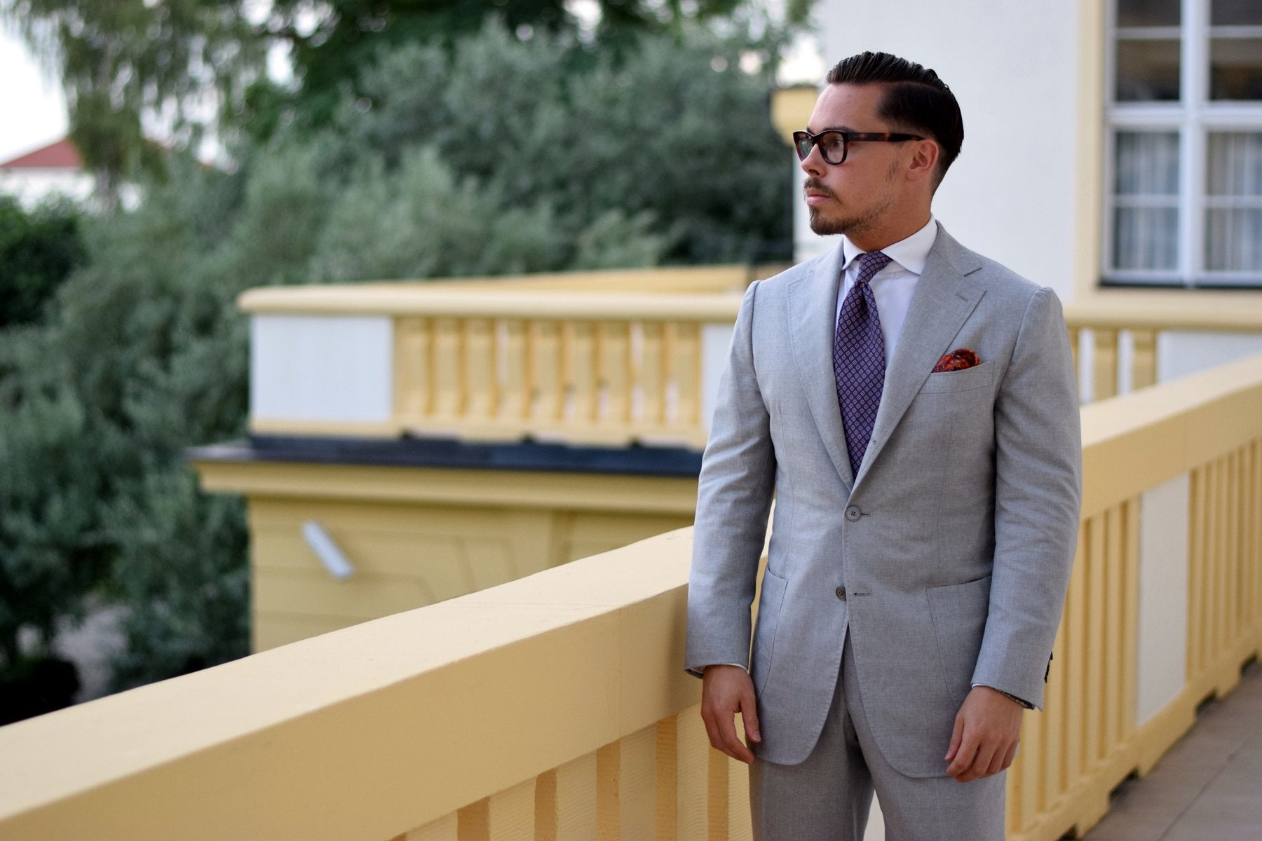 Light gray suit with orange accessories