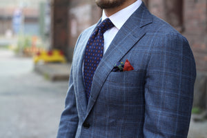 Printed silk tie with a gray suit