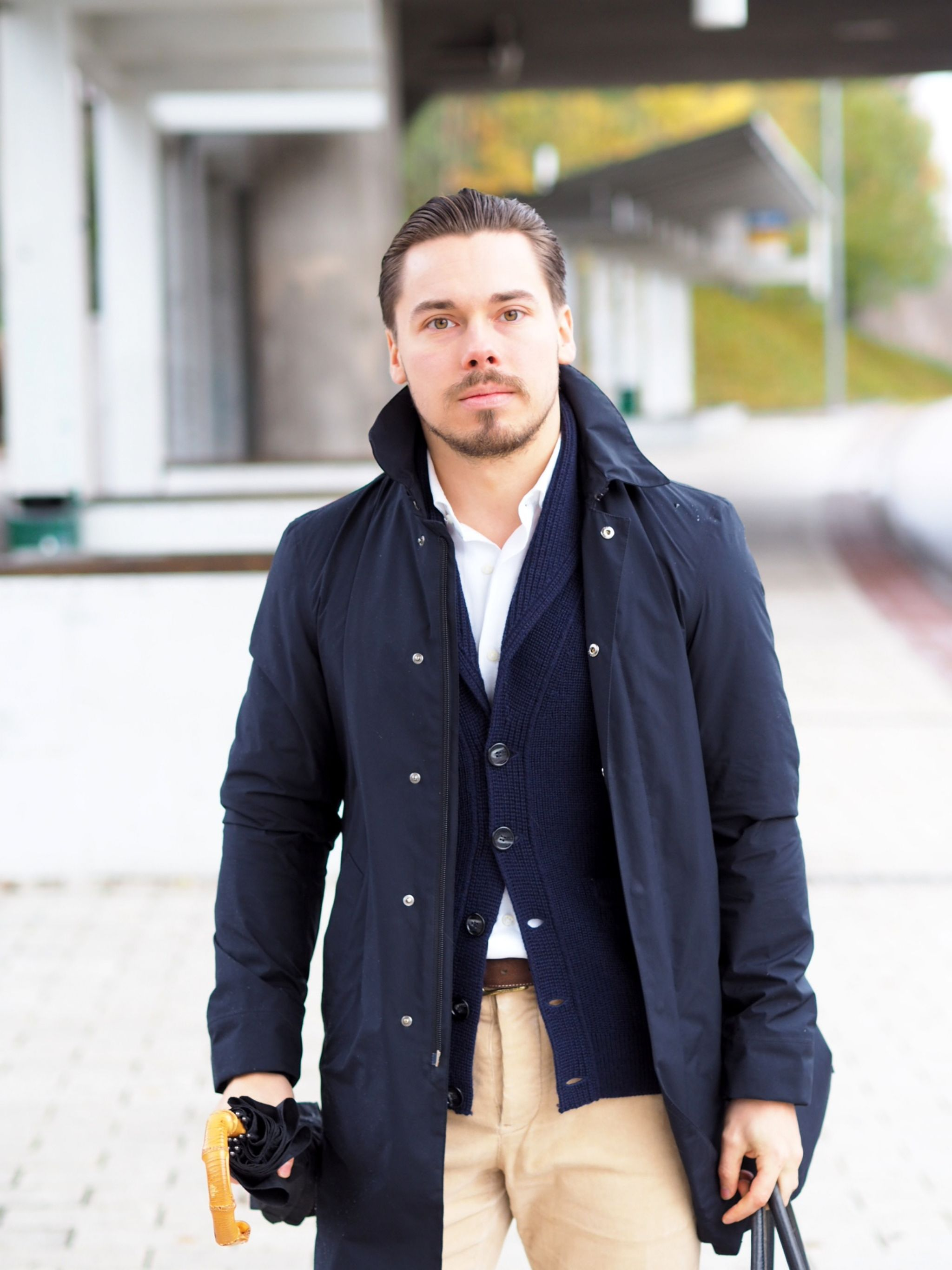 The classic rain mac with a casual shawl collar cardigan and corduroy trousers