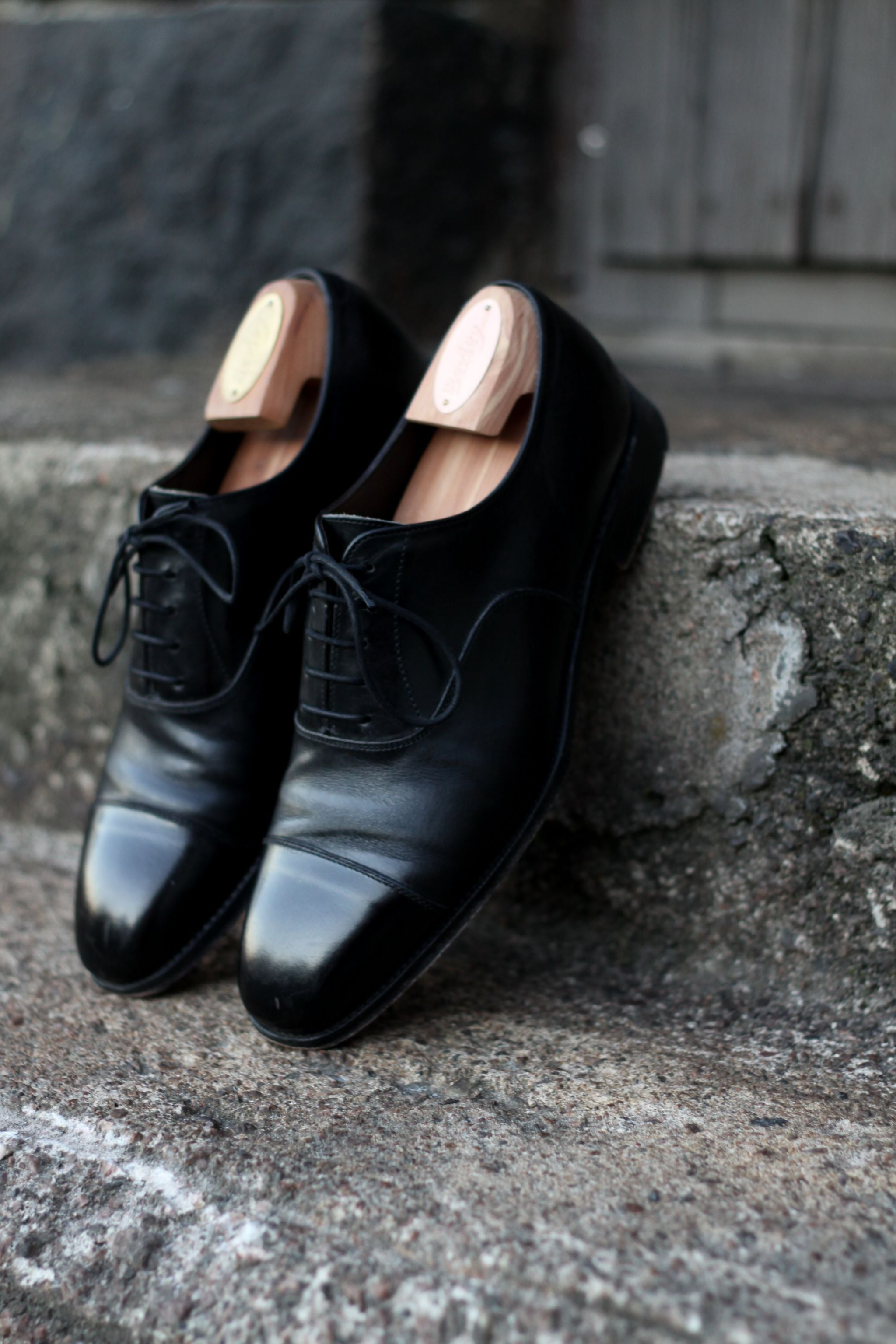 Black cap toe oxfords by Alfred Sargent