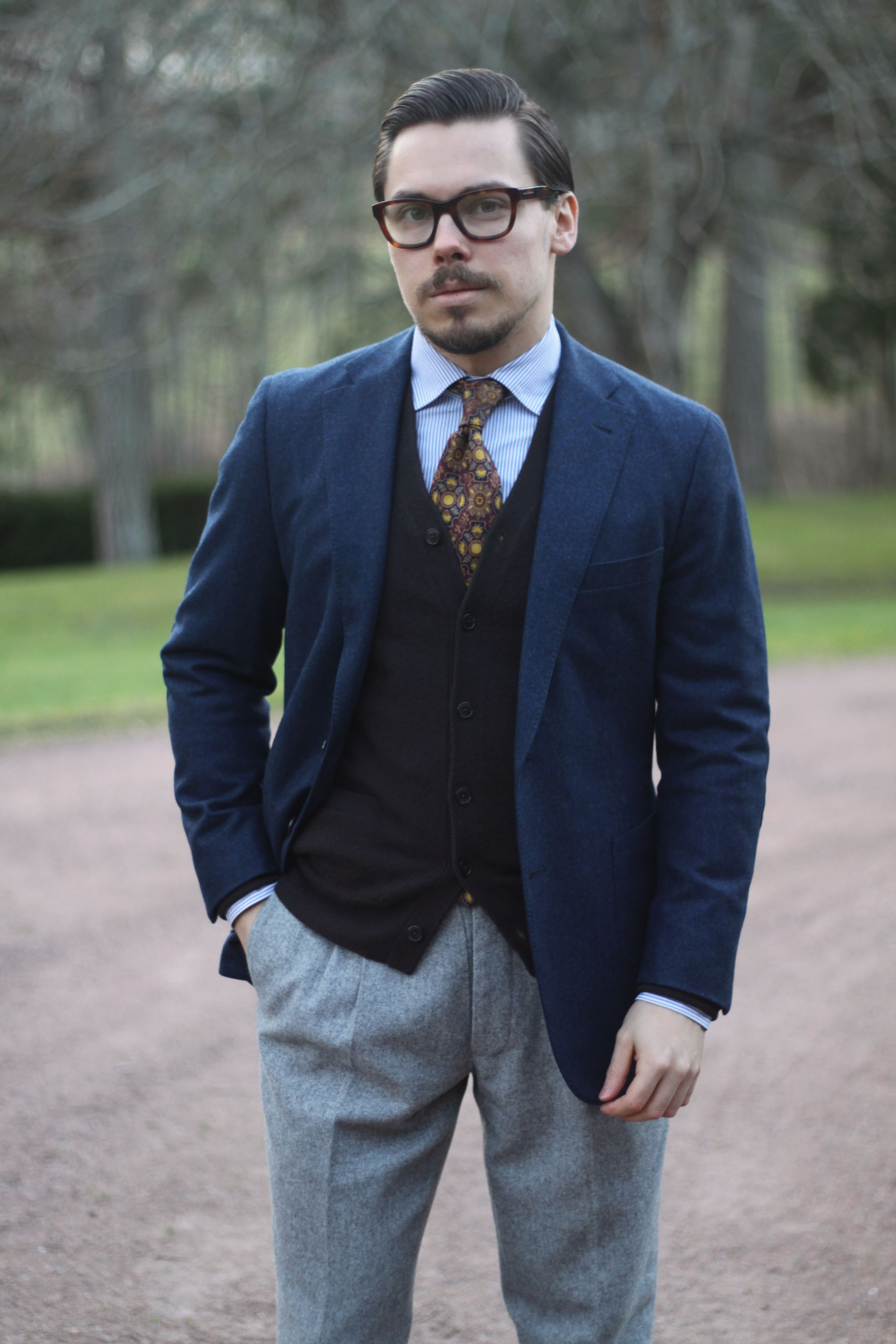 Blue flannel wool blazer with gray flannel trousers