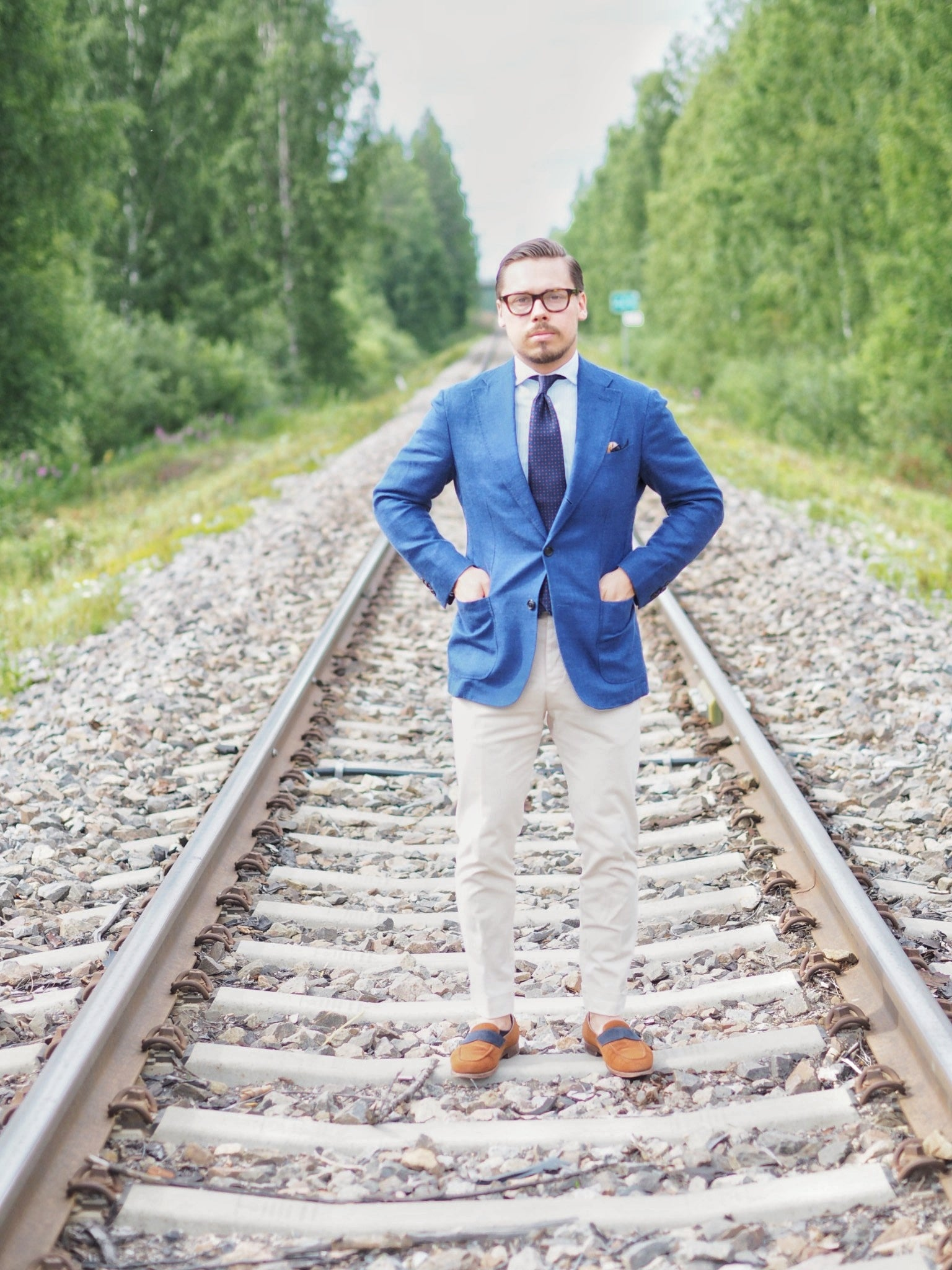 Blue suit jacket as a sport coat - full shot wearing the jacket with light colored cotton slacks