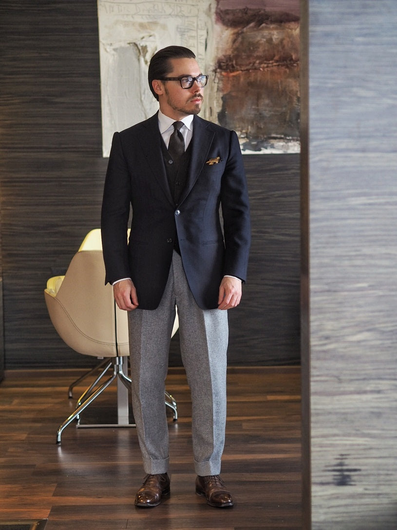 3 different ways to wear the blue suit - Blue suit jacket with gray flannel trousers and cardigan.