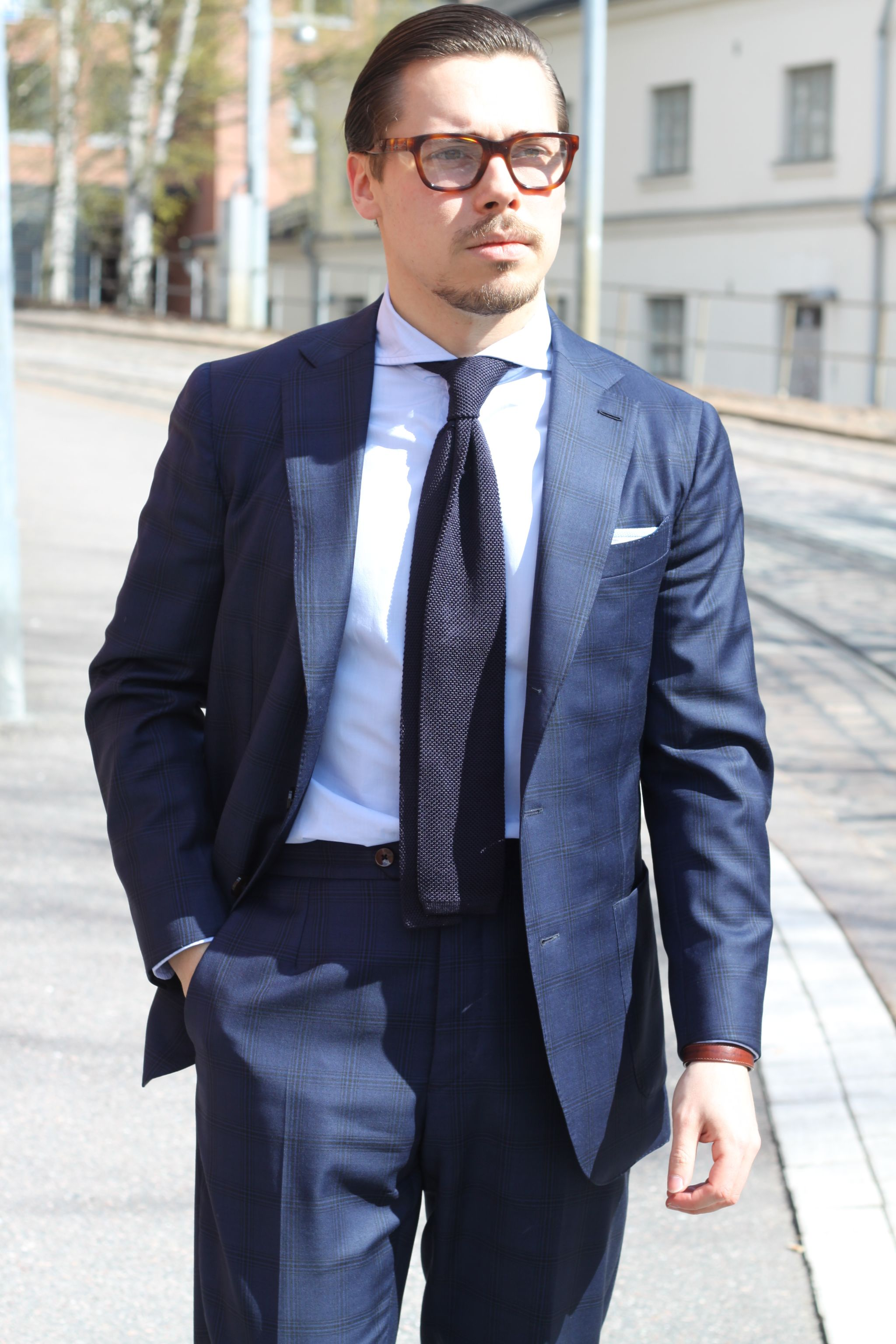 Blue suit with light blue shirt and knitted tie