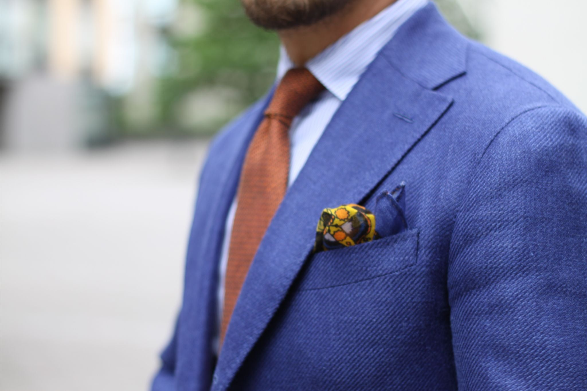 Blue suit with orange tie and pocket square