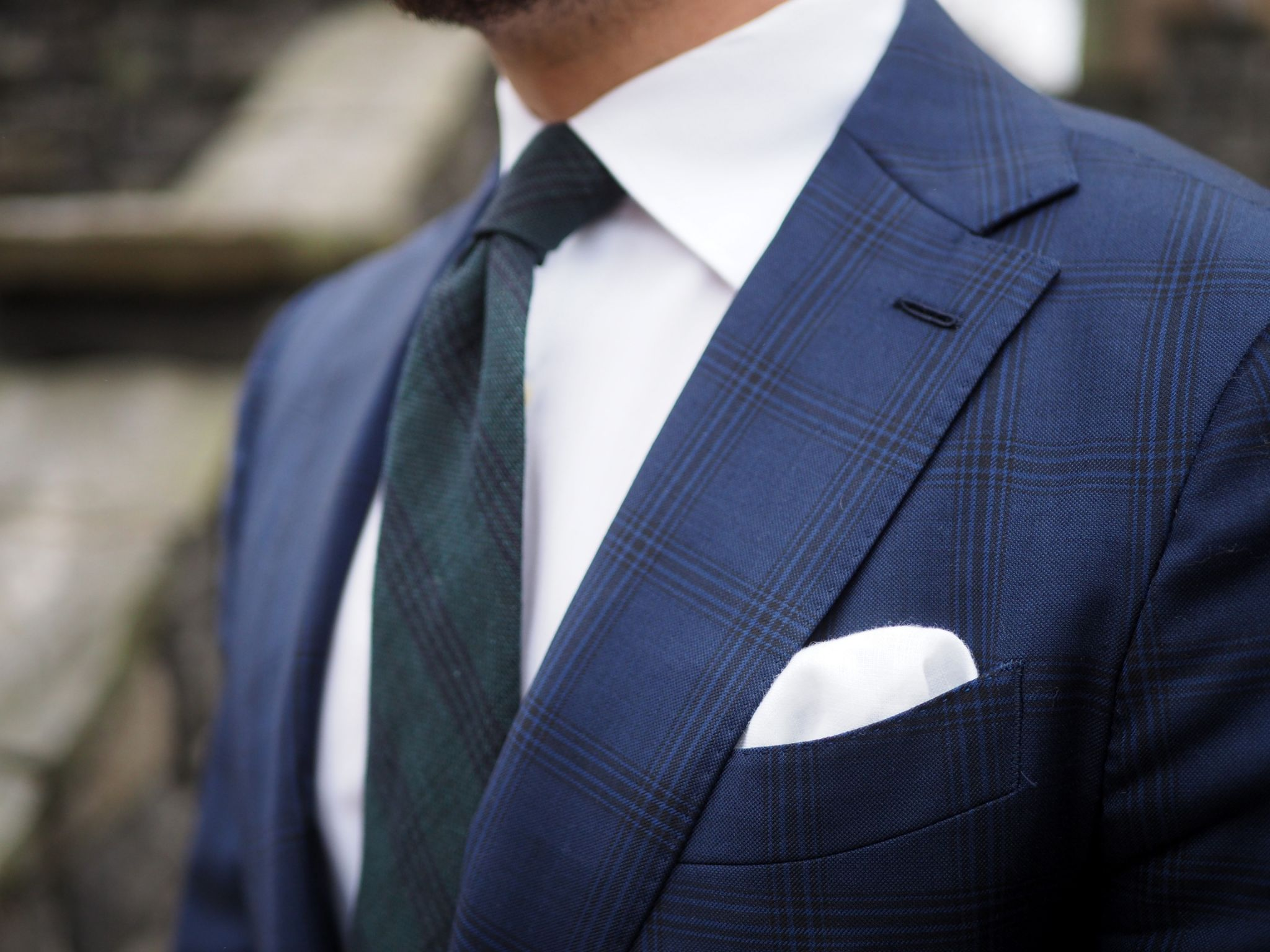 Bottle green tie for business wear - details of the tie and suit