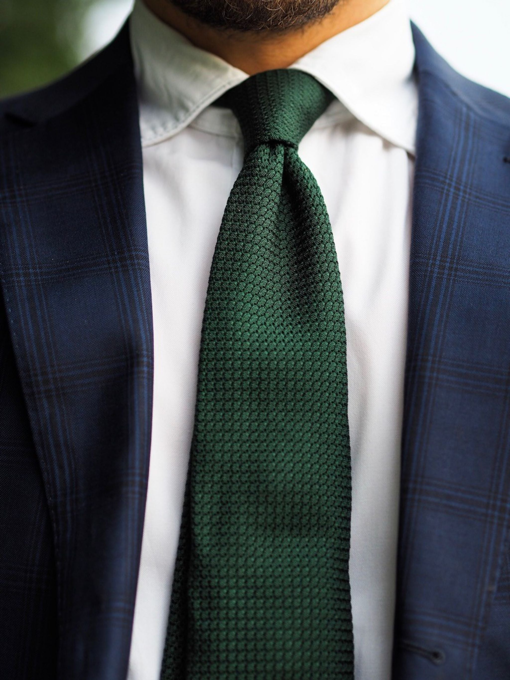Bottle green grenadine tie with four-in-hand knot