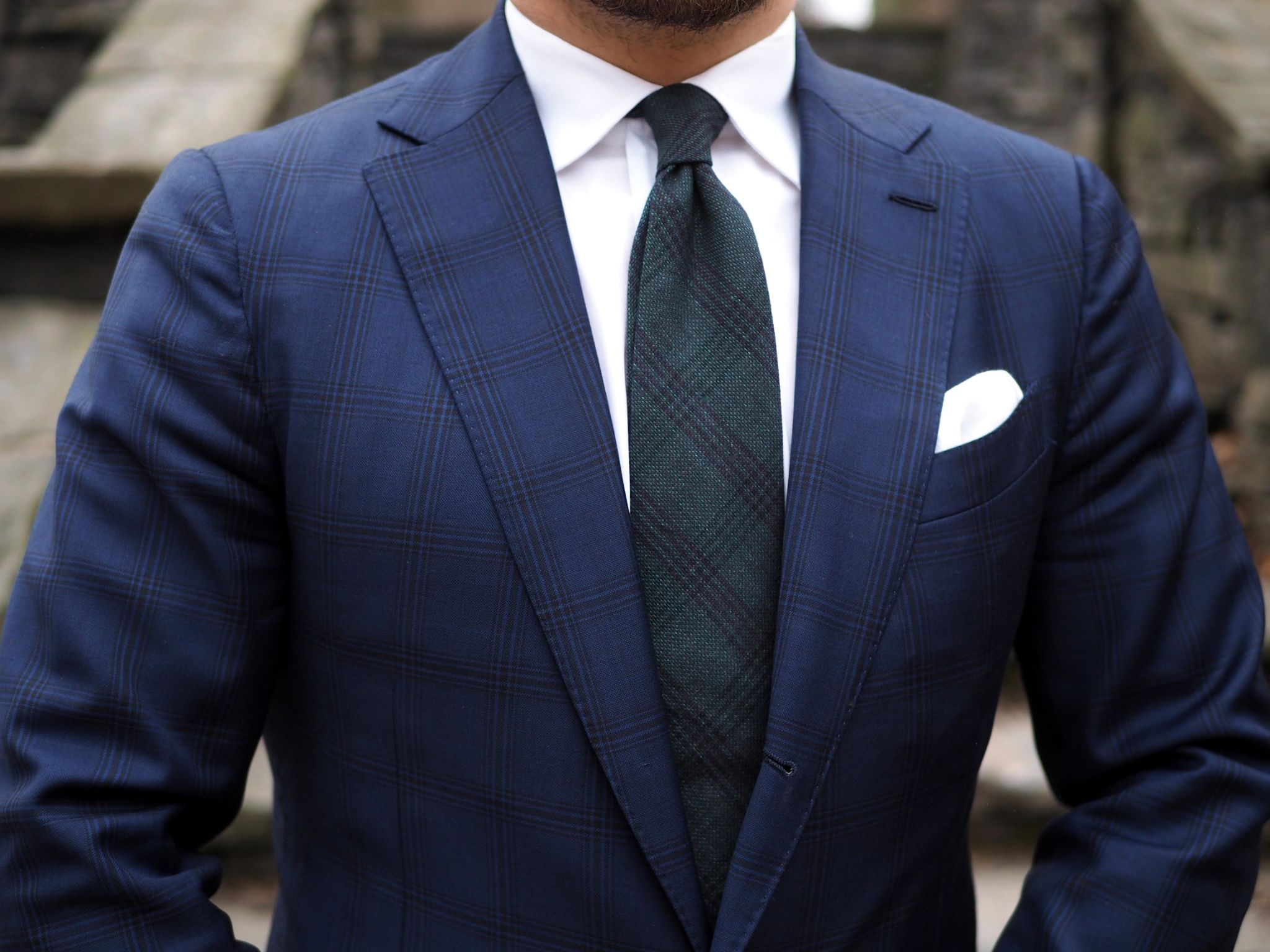 Bottle green tie for business wear - close-up with the suit and tie