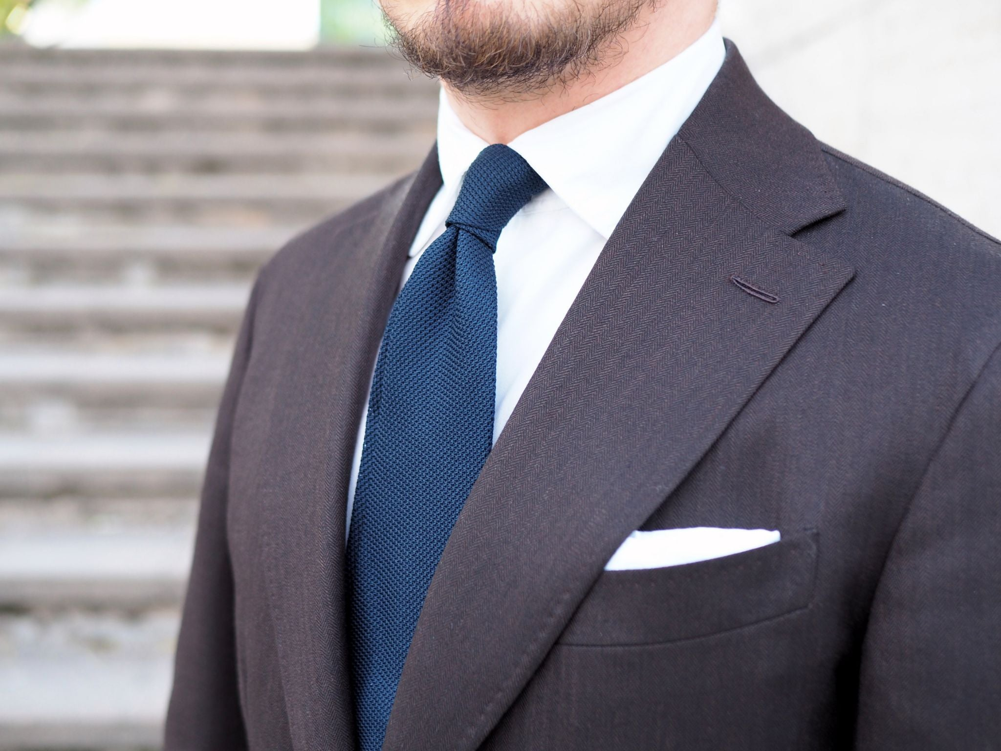 Brown business suit - the double four-in-hand knot and navy blue DLA grenadine tie
