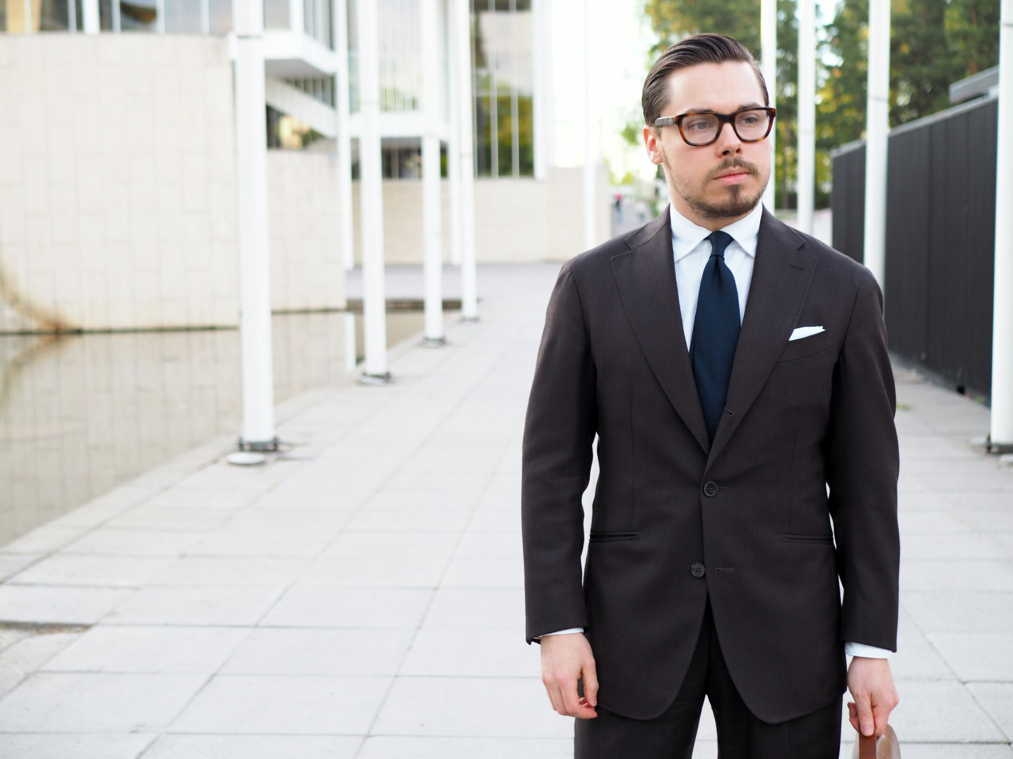 Brown business suit with formal accessories.