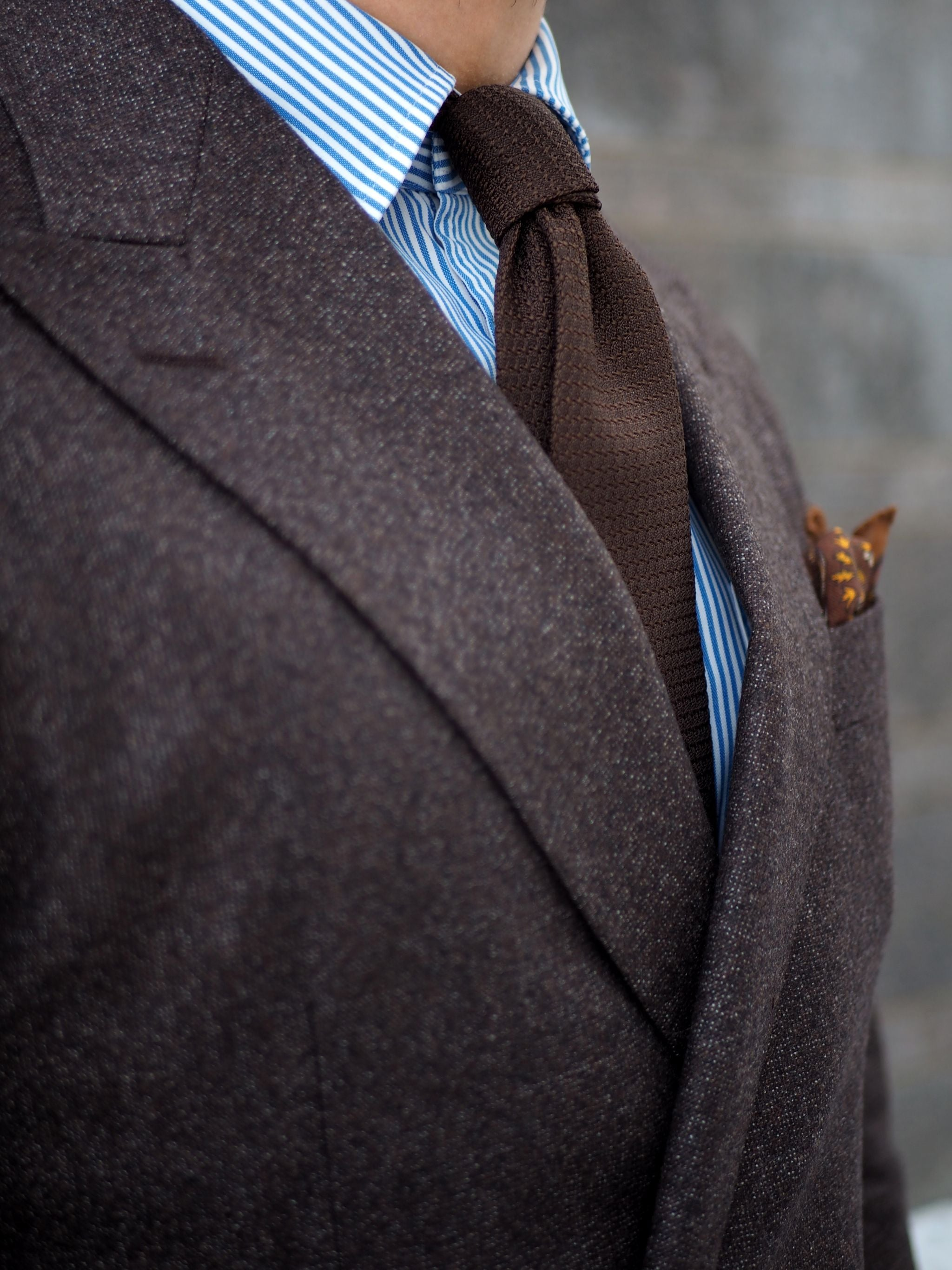 Brown garza grossa grenadine tie with the double four-in-hand knot.