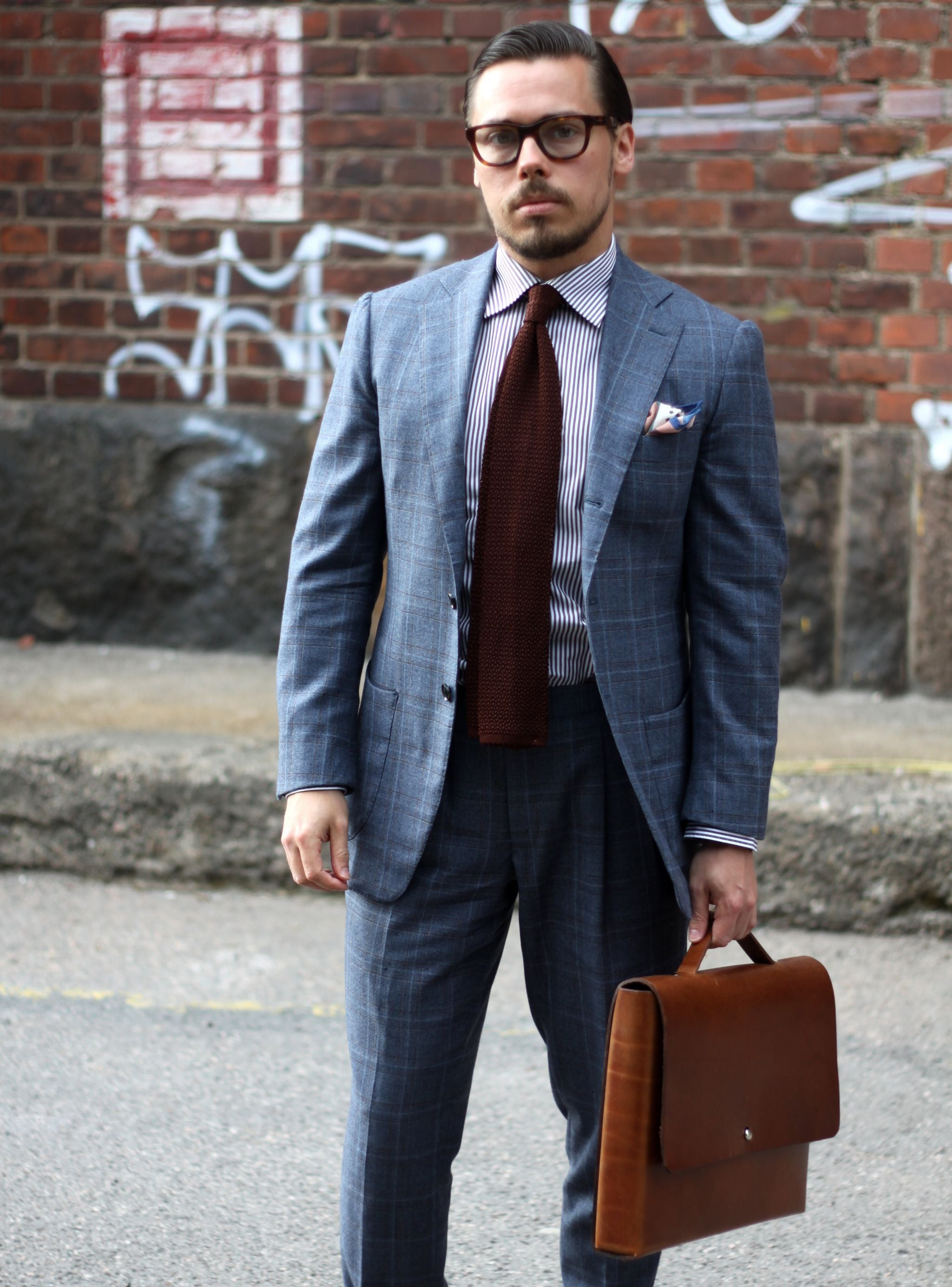 Brown knit tie with suit and striped shirt