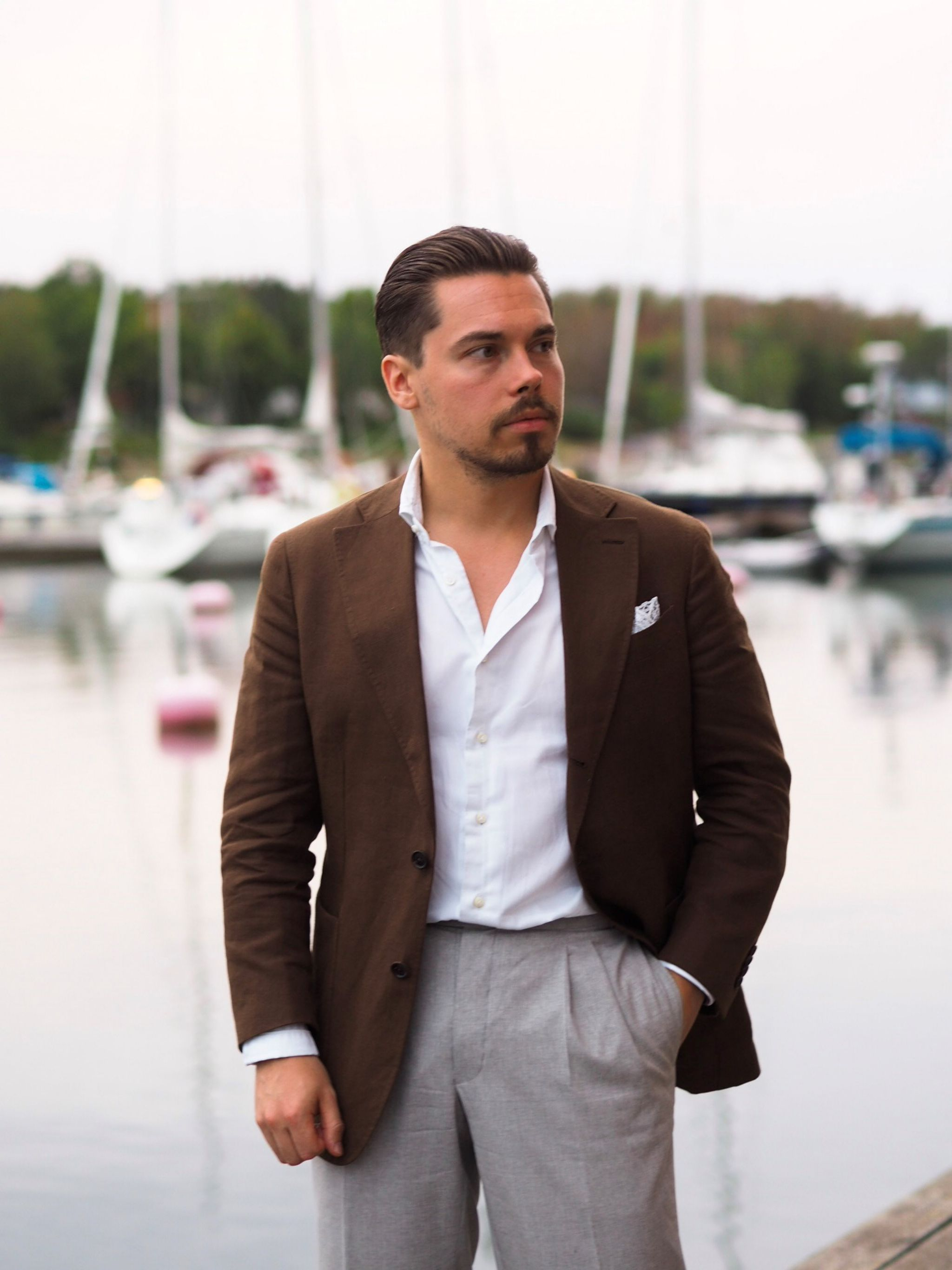 Brown linen suit jacket with light gray suit trousers
