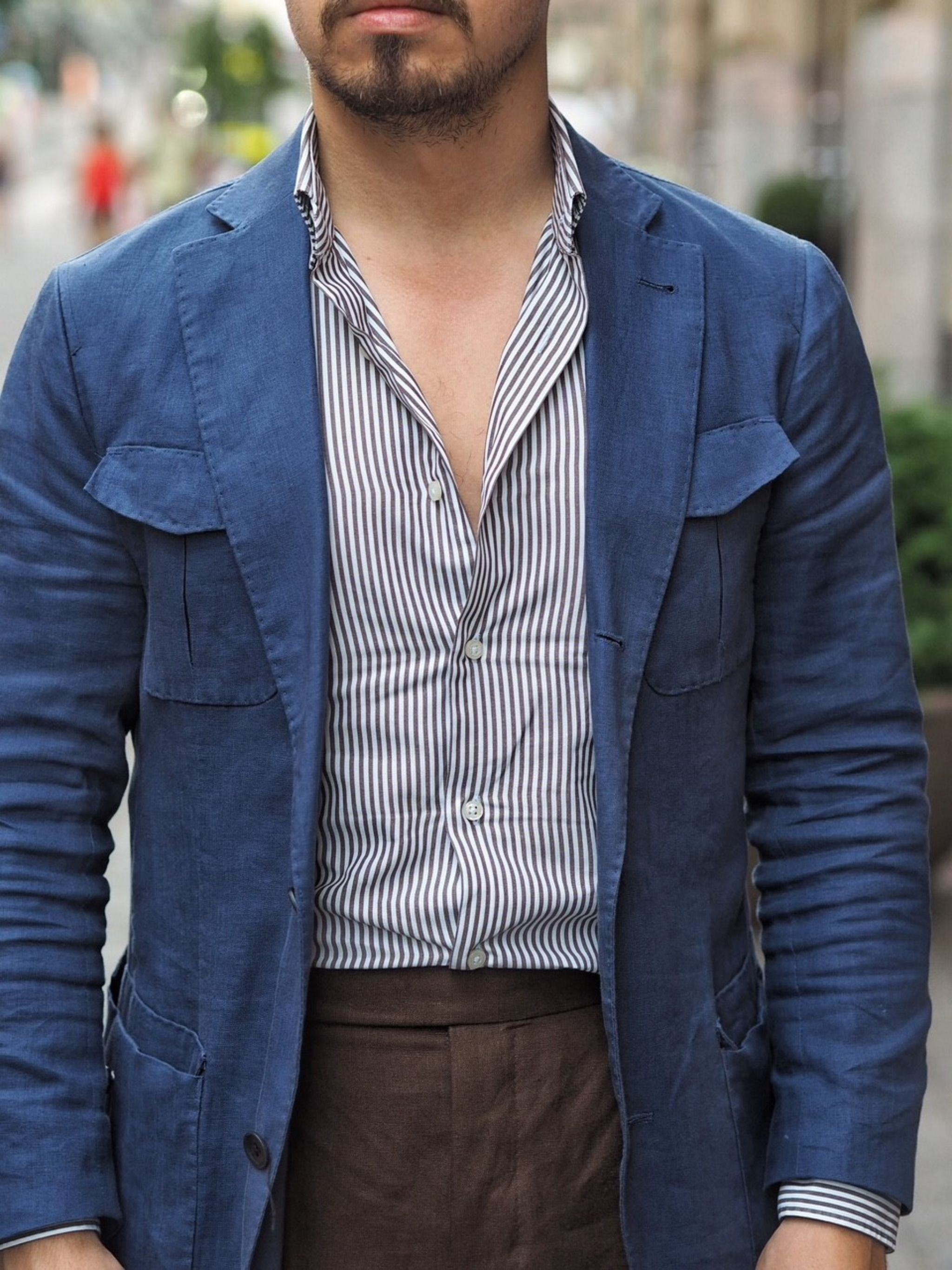 Brown linen suit trousers with striped shirt and navy jacket details