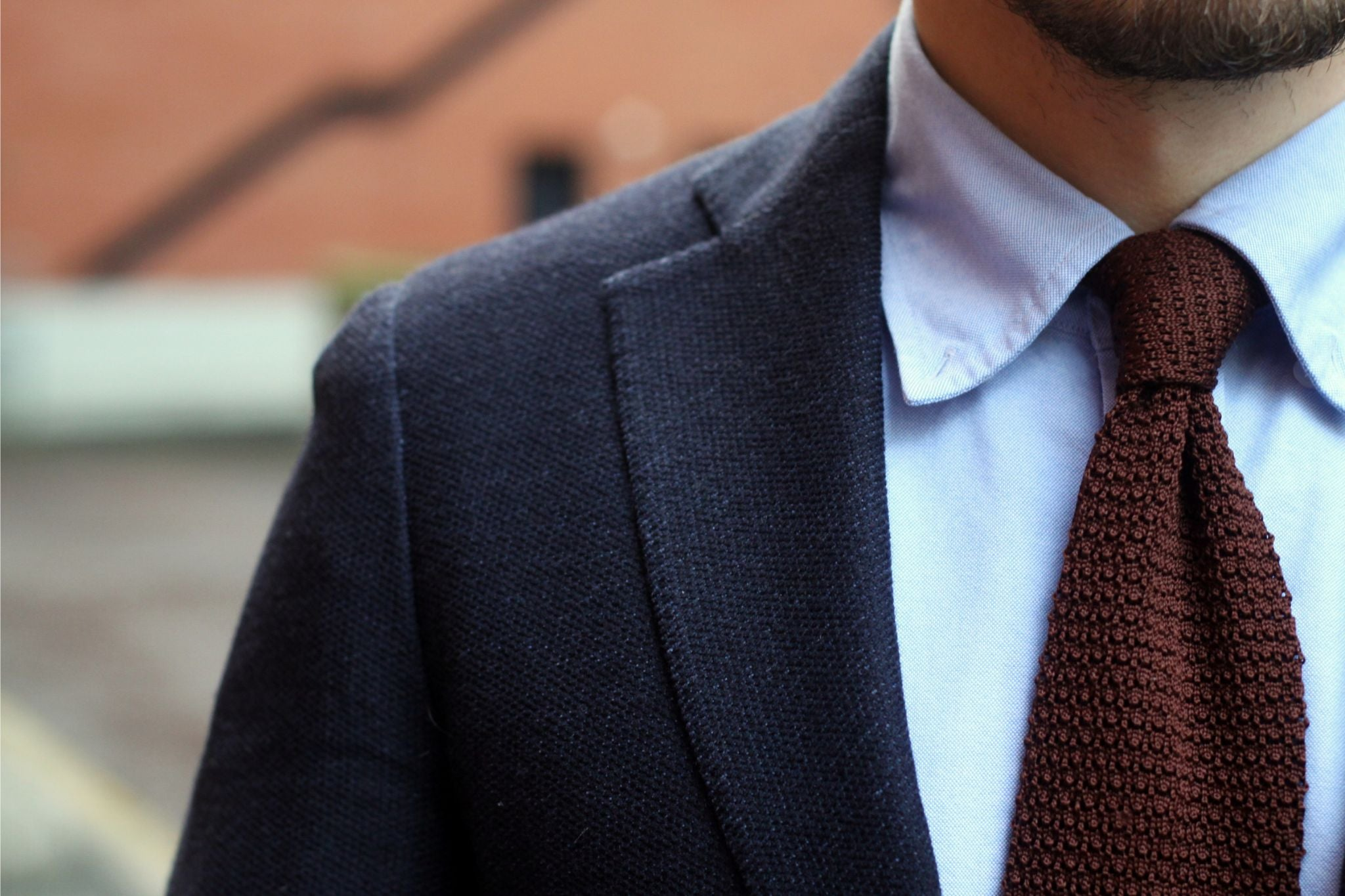 Blue jersey sport coat with corduroy trousers - brown silk knitted tie details