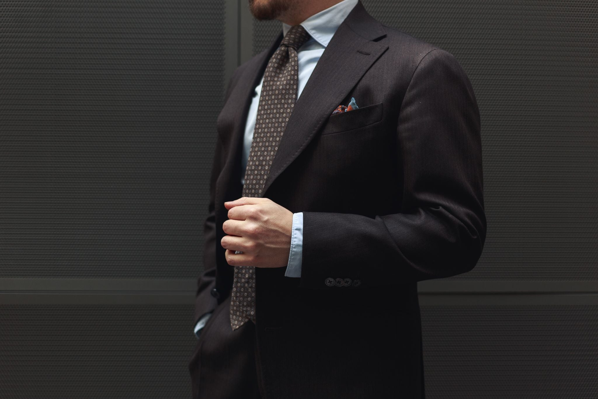 Brown business suit - show the right amount of cuff underneath your suit jacket.
