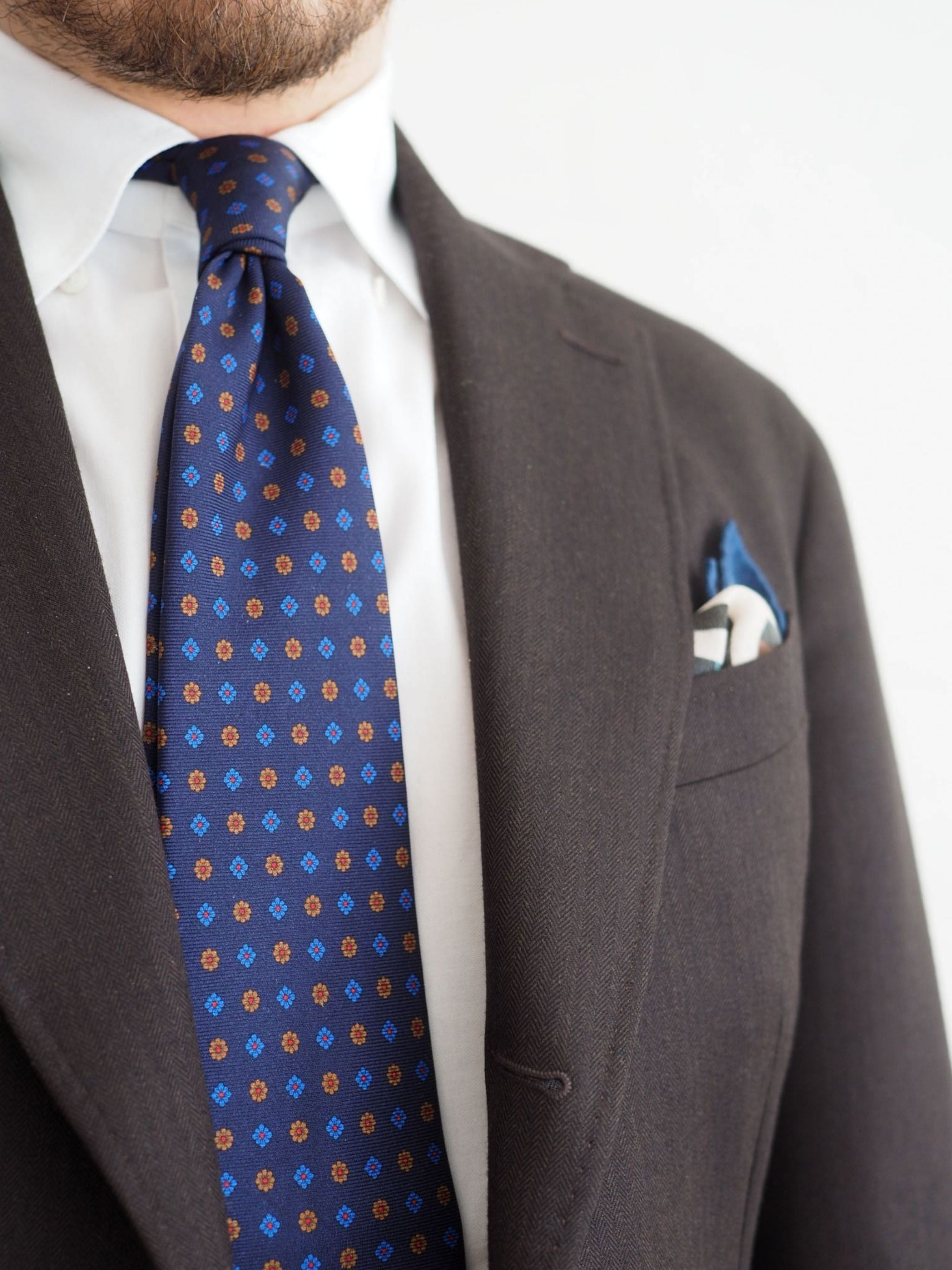 Favorite suits - details of brown suit and blue printed floral tie